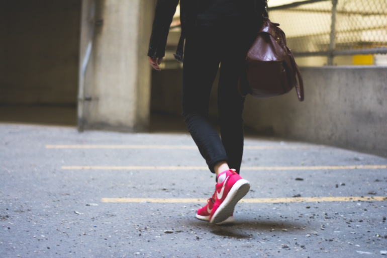 Woman walking in pink Nike trainers